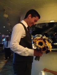 Flavia's nephew holding her bouquet